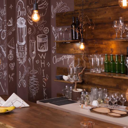 https://maharis.ma/wp-content/uploads/2021/02/empty-cafe-bar-interior-design-with-artistic-drawi-EVL3W7H-540x540.jpg